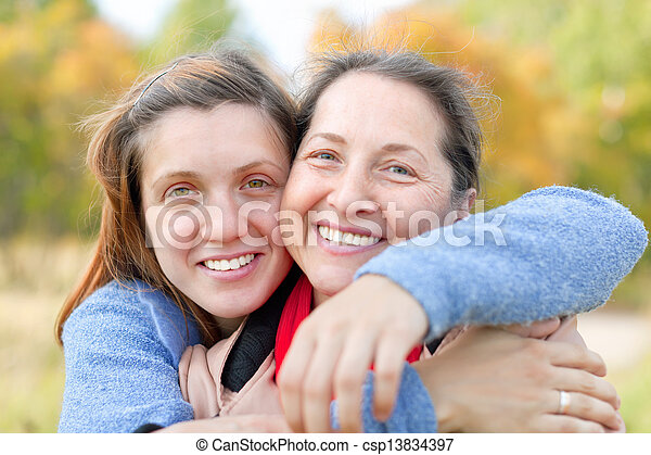 woman with adult daughter in autumn   - csp13834397