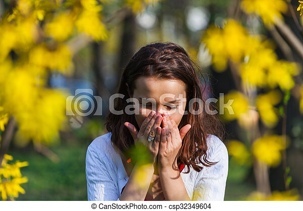 Woman with allergy sneezing - csp32349604