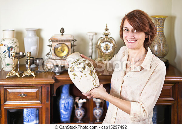 Woman with antique collection - csp15237492