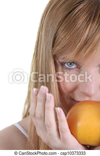 Woman with apple on white background - csp10373333