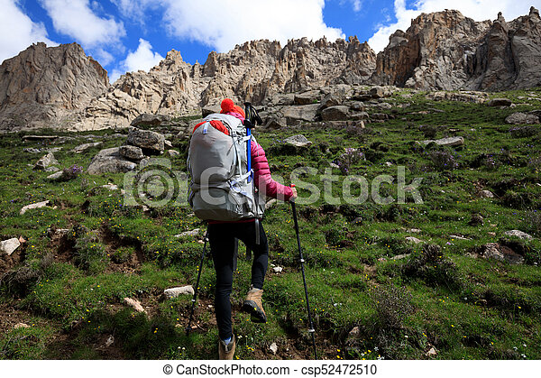 woman with backpack hiking in mountains - csp52472510