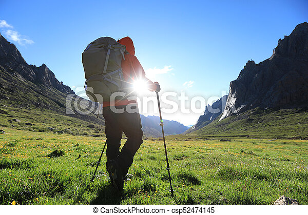 woman with backpack hiking in mountains travel lifestyle - csp52474145