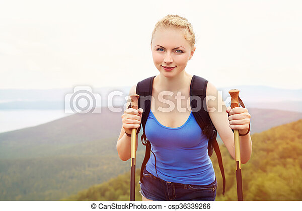 woman with backpack hiking in the mountains - csp36339266