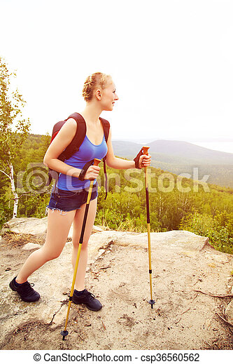 woman with backpack hiking in the mountains - csp36560562