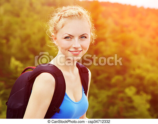 woman with backpack hiking in the mountains - csp34712332