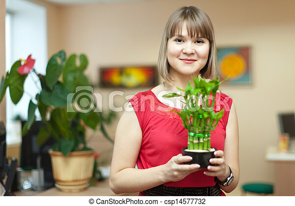 woman with  bamboo plant  - csp14577732