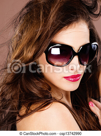 woman with big black sun glasses - csp13742990
