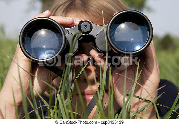Woman with binoculars is discovering the surrouding - csp8435139