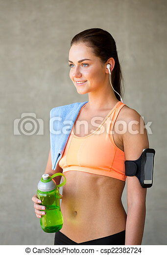 woman with bottle of water in gym - csp22382724