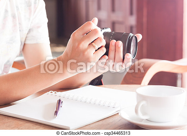 Woman with camera in the hands - csp34465313