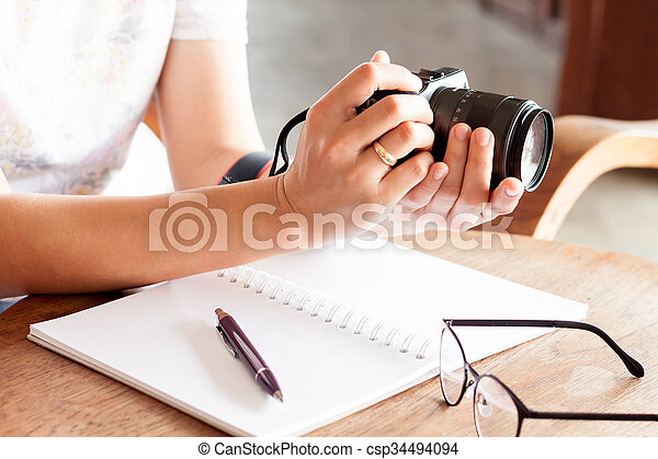 Woman with camera in the hands - csp34494094