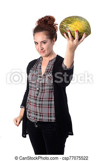 woman with cantaloupe on white background - csp77075522