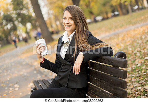 Woman with coffee outdoor - csp38992363