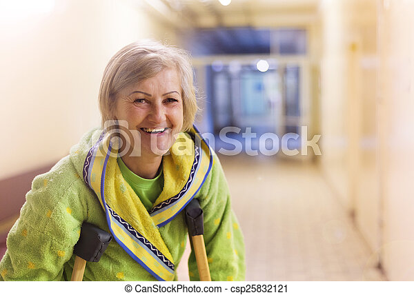 Woman with crutches - csp25832121