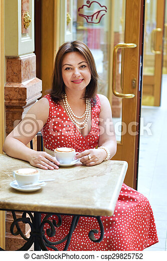 woman with Cup of coffee in the cafe - csp29825752