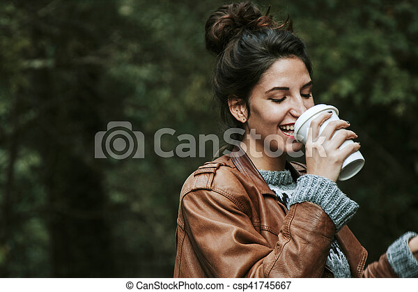 woman with cup of coffee on the street, fast food - csp41745667