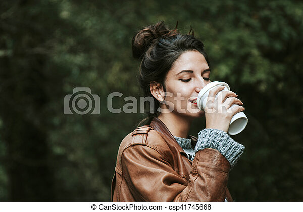woman with cup of coffee on the street, fast food - csp41745668