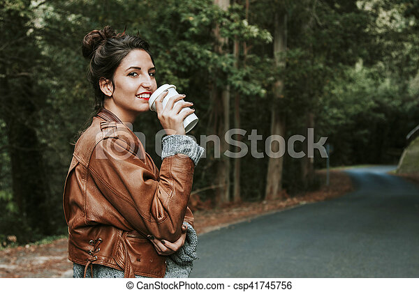 woman with cup of coffee on the street, fast food - csp41745756