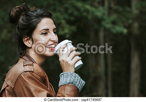 woman with cup of coffee on the street, fast food - csp41745697