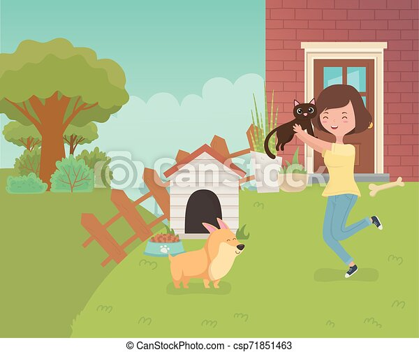 woman with cute little cat and dog in the house garden - csp71851463