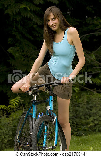 Woman with cycle - csp2176314