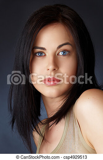 0ac3396c5ca4d Woman with dark hair in bob. Beautiful young woman with blue eyes ...