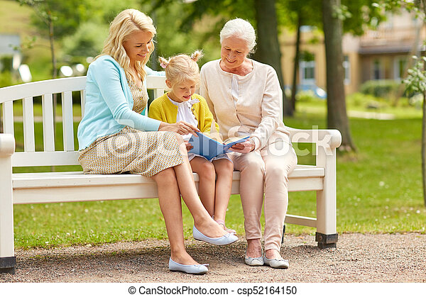 woman with daughter and senior mother at park - csp52164150