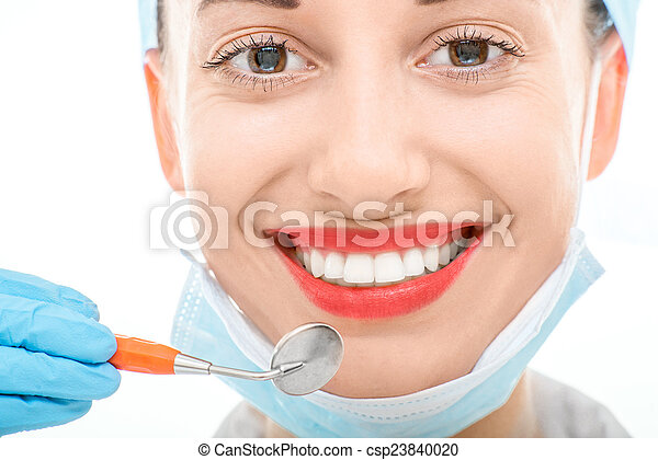 Woman with dental mirror on white background - csp23840020