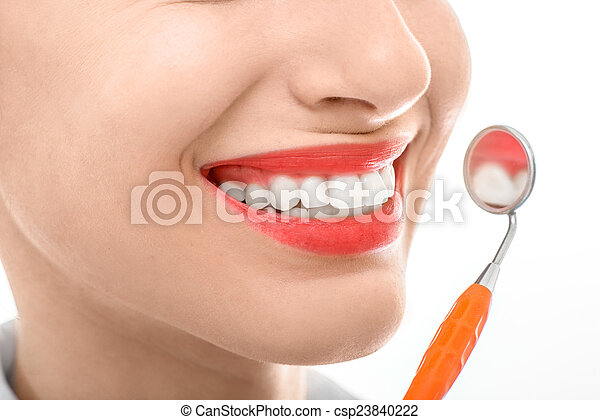 Woman with dental mirror on white background - csp23840222