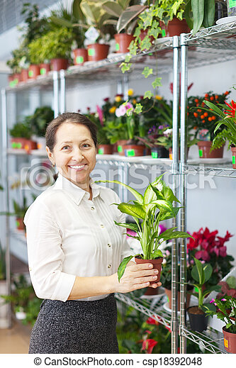 woman with Dieffenbachia plant  - csp18392048