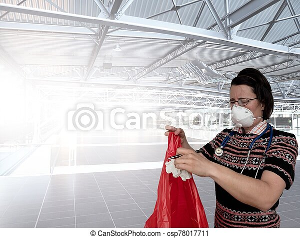Woman with face breathing protection mask - csp78017711