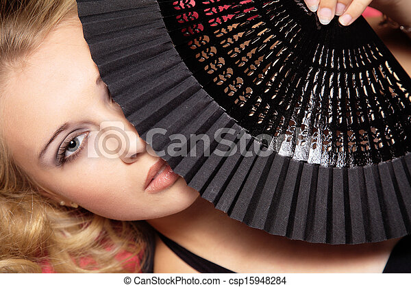 woman with fan - csp15948284