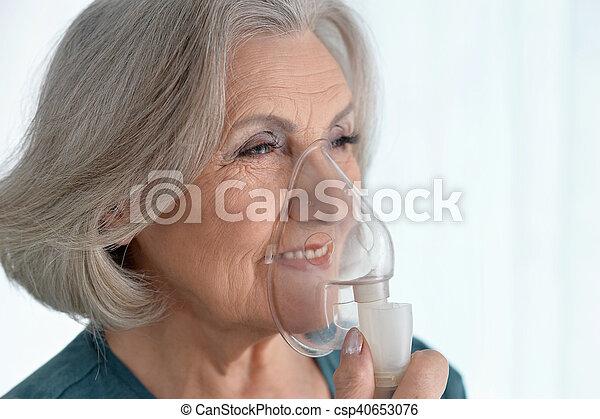 woman with flu inhalation - csp40653076