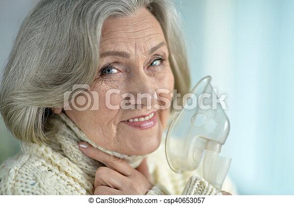 woman with flu inhalation - csp40653057