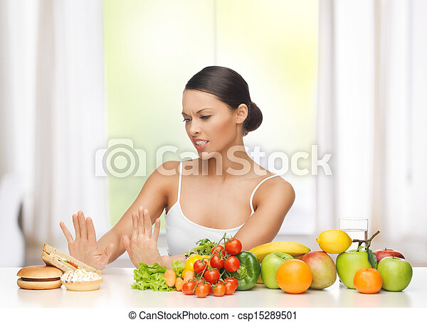 woman with fruits rejecting junk food - csp15289501