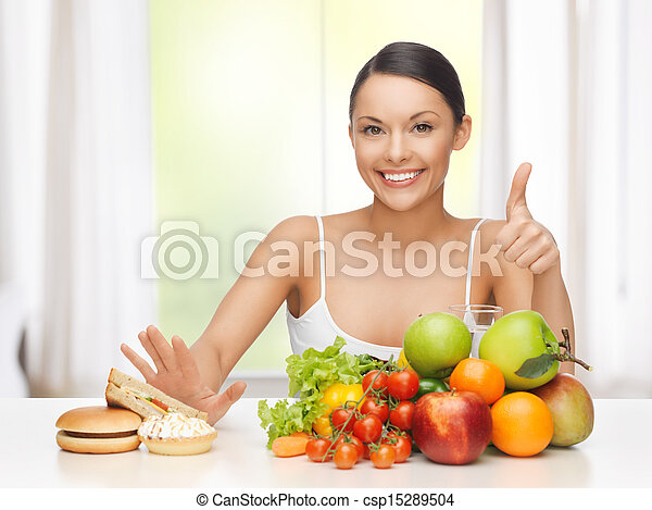 woman with fruits rejecting junk food - csp15289504