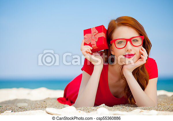 woman with gift box on the beach - csp55360886
