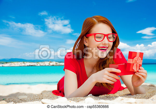 woman with gift box on the beach - csp55360666
