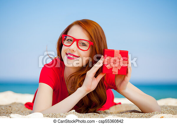 woman with gift box on the beach - csp55360842