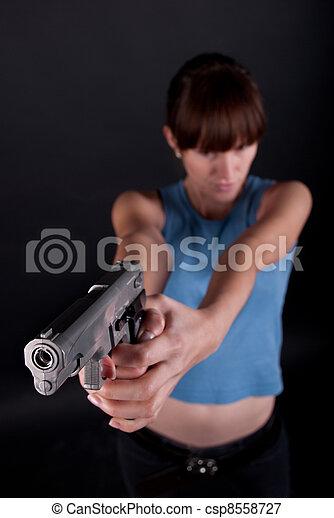woman with gun - csp8558727