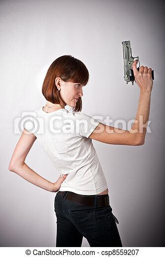 woman with gun - csp8559207