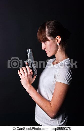 woman with gun - csp8559378