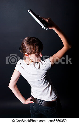 woman with gun - csp8559359