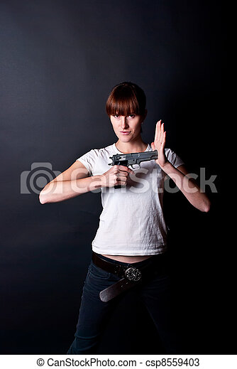 woman with gun - csp8559403