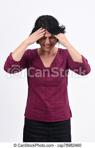 woman with headache on white background - csp78982460
