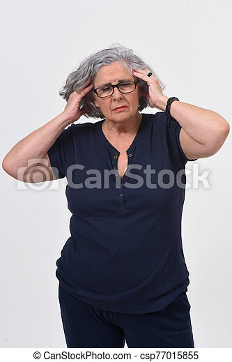 woman with headache on white background - csp77015855