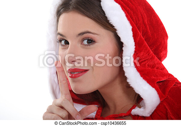 Woman with her finger to her lips - csp10436655
