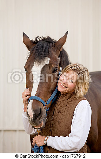 Woman With Her Horse - csp1767912