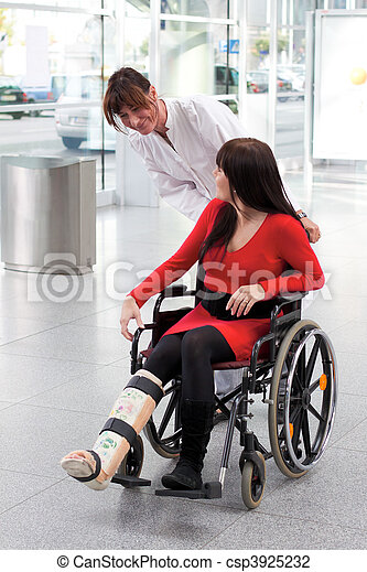 Woman with leg in plaster, wheelchair and nurse - csp3925232
