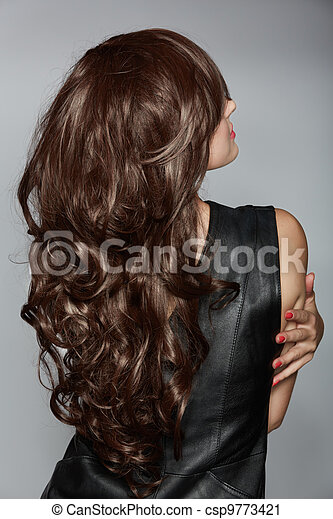 woman with long brown curly hair - csp9773421